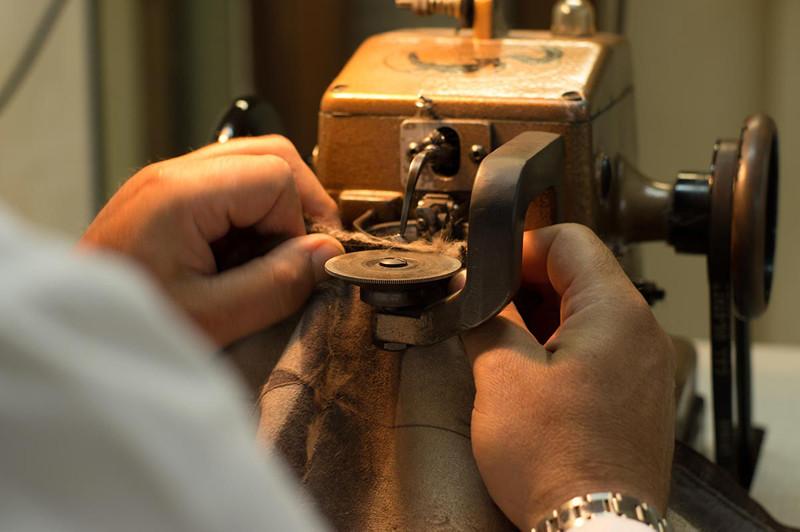 foto processo lavorazione cucitura sherì - piano alto